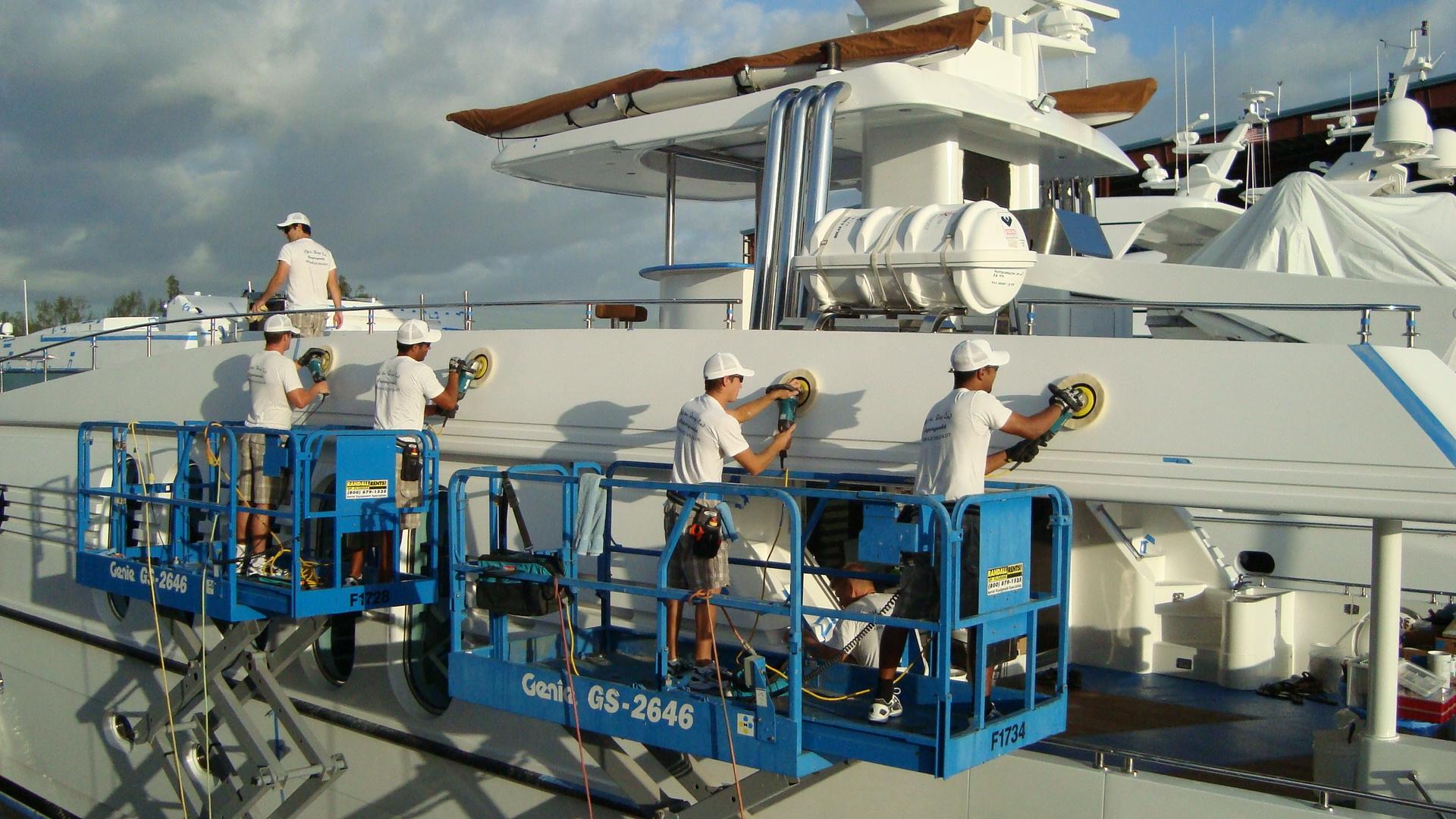 otde-crew-polishing-yacht